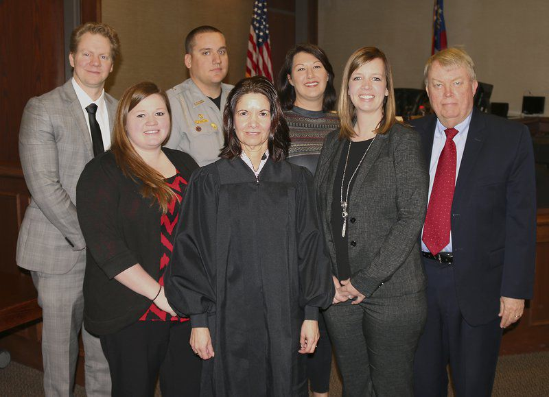 The members of the Lowndes County DUI Court: Probation Officer Kayla Porter, Judge Ellen Golden, Court Coordinator Stacey Bass, Defense Attorney Richard Shelton, Assistant Solicitor-General Matthew P. Brown, Deputy Jared Davis and treatment provider Laci Rankhorn.